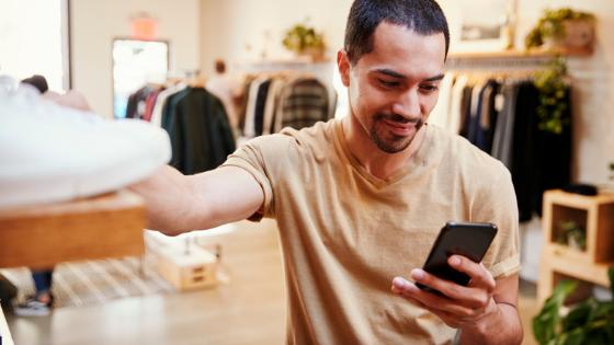 man shopping and looking at phone