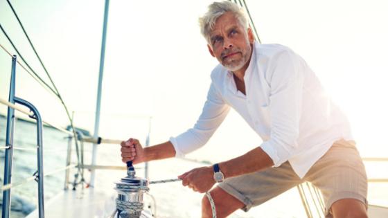 Senior man on sail boat