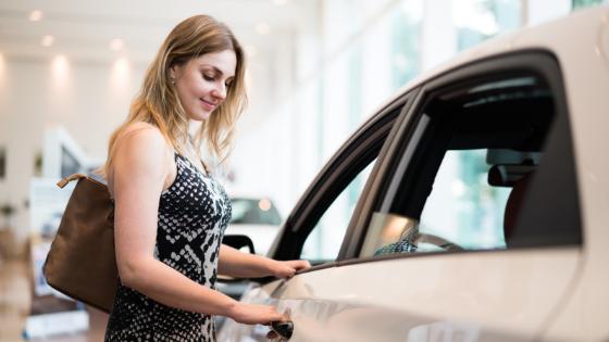 Woman looking at car