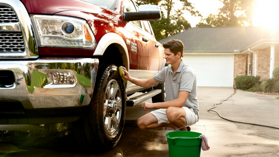 Young man washing truck
